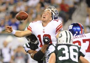 giants-quarterback-eli-manning-is-sacked-by-the-jets
